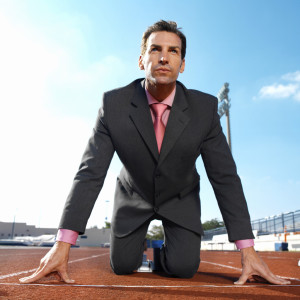 Businessman on Start Line of Running Tract --- Image by © Royalty-Free/Corbis