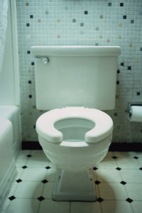 ca. 2002 --- Motel Room Toilet --- Image by © Royalty-Free/Corbis